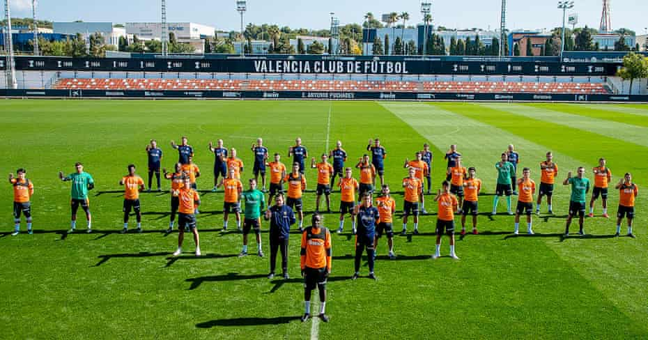 Valencia players and staff show their support to defender Mouctar Diakhaby the day after their game.