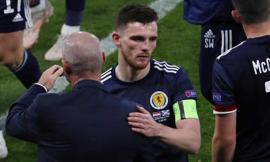 Scotland captain Andy Robertson is consoled by Steve Clarke