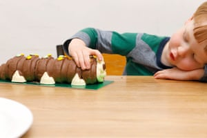 M&S's Colin the caterpillar cake meets a young fan.