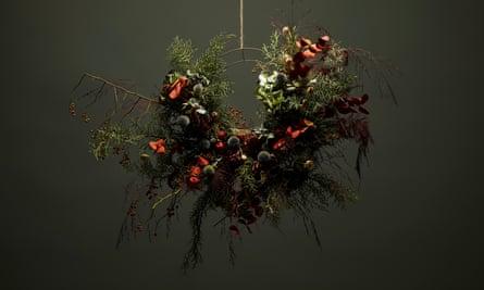 Wreath of sprayed dried eucalyptus, rosehip, crab apples, echinops, conifer, grasses, asparagus fern and green hydrangea