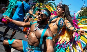 Revellers take part in the 2019 Notting Hill Carnival in London.
