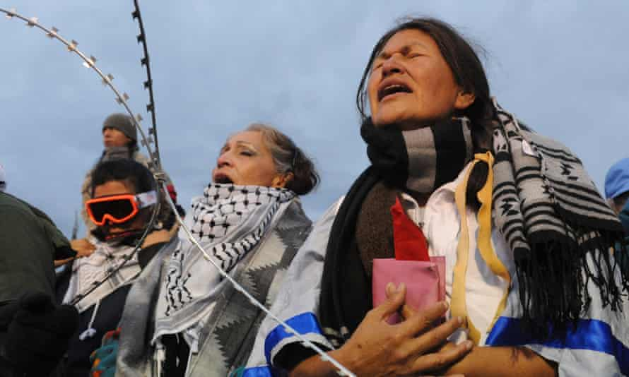 Women hold a prayer ceremony during a protest against the Dakota Access pipeline.