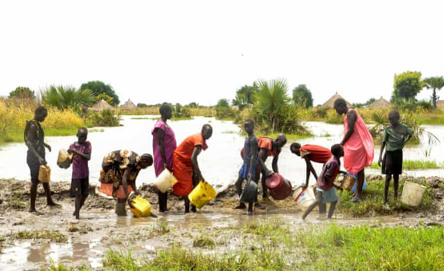 People try to block flood water from broken dykes on the Nile in South Sudan last September. 'Destruction of our natural environment and other human rights failures have created enormous fragilities in our societies,' said Guterres.