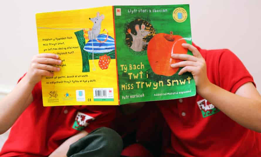 Children with a Welsh language book.