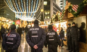 Police walk through the reopened Christmas market in Berlin on 22 December 2016