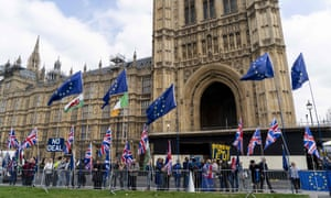 Flags put up by pro and anti-Brexit campaigners outside the Houses of Parliament.