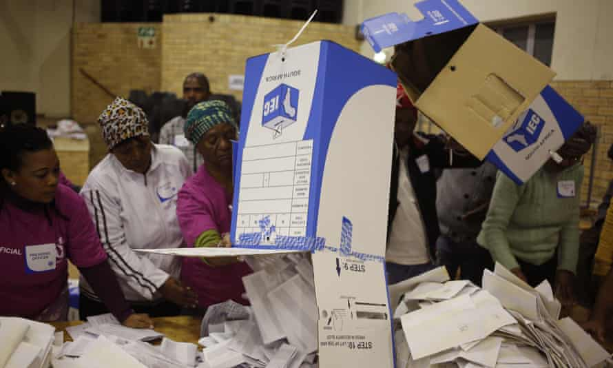 Election officials start the ballot counting process at a polling station during local elections in Manenberg on the outskirts of Cape Town, South Africa.