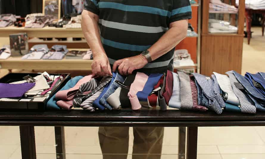 A man shops for ties at House of Fraser in Guildford, Surrey