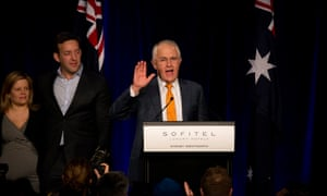 Malcolm Turnbull addresses the party faithful after midnight as the result of the Australian election remains unclear