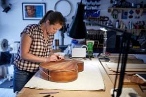 Heydenrych adds the finishing touches to a guitar