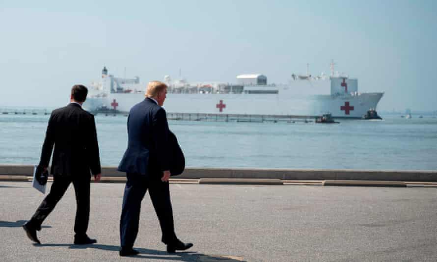Trump waves off the US navy hospital ship USNS Comfort in Norfolk, Virginia on Saturday.