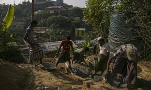 Rohingya refugees build a structure in a refugee camp in Cox's Bazar, Bangladesh