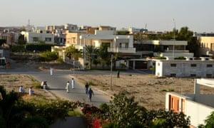 People play street cricket in a DHA suburb in Karachi