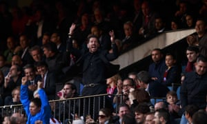 Atlético Madrid's Diego Simeone encourages the crowd after being sent to the stand by the referee after a ball was thrown on to the pitch.
