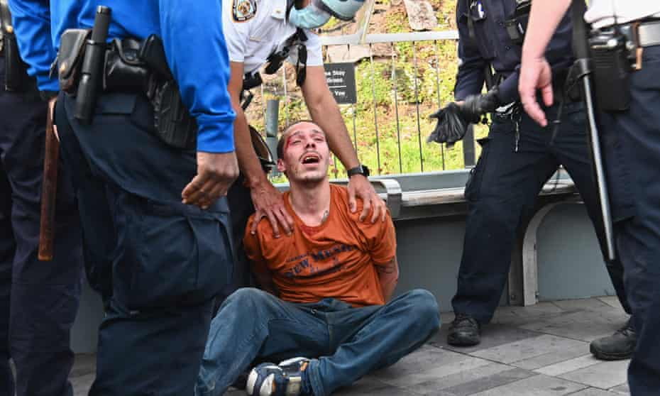 NYPD police officers arrest a protester during a demonstration on Monday.