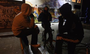 Young people in hooded tops on a housing estate