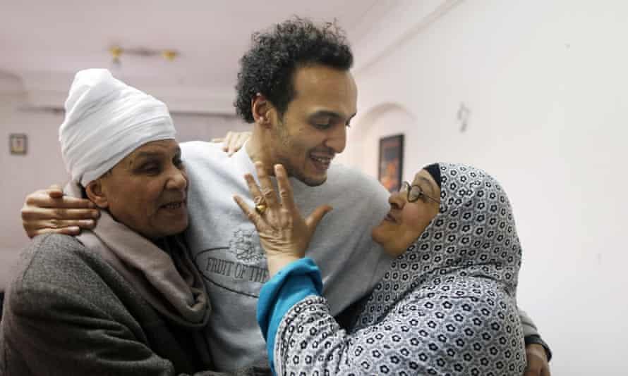 Mahmoud Abu Zaid is hugged by his parents.