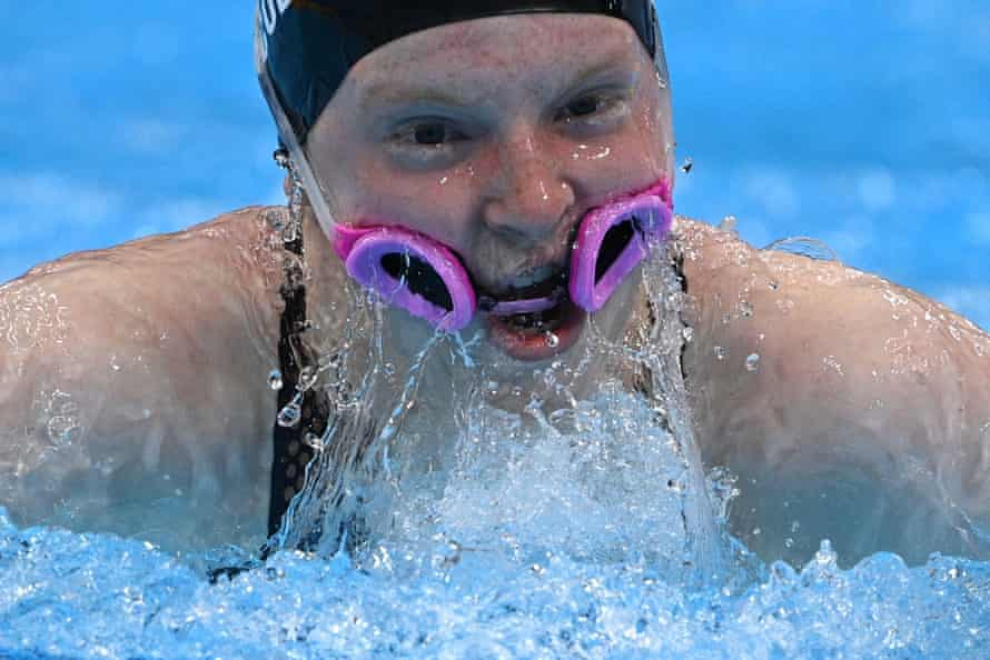 Lydia Jacoby, with her goggles around her mouth, competes in the final of the mixed 4x100m medley relay swimming event.
