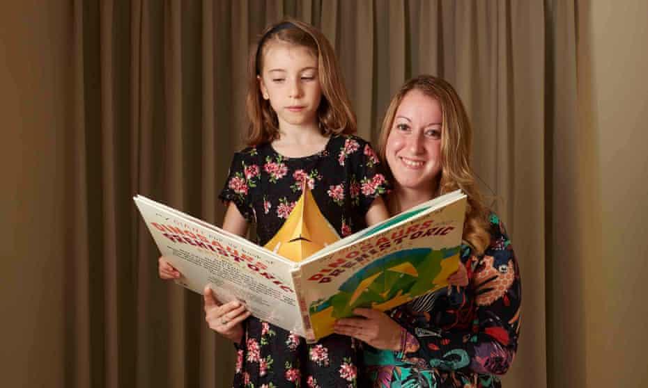 Donna and Flora Ferguson holding an open children's book
