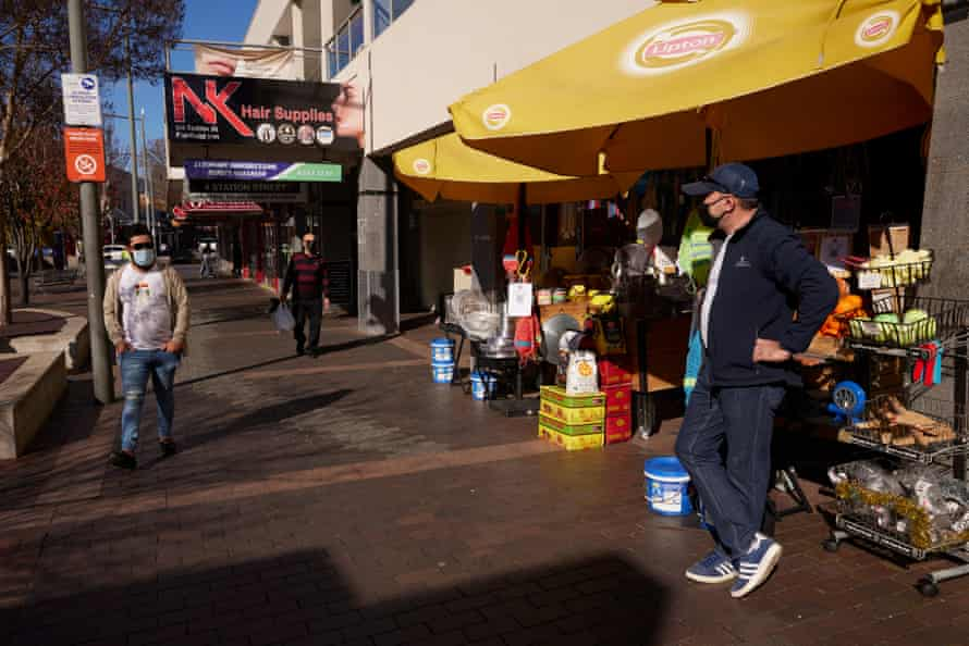 A shopkeeper waits for customers in Fairfield on 15 July 15 during Sydney's lockdown