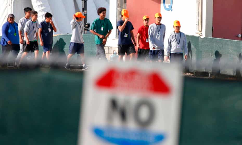 Migrant children who have been separated from their families walk at a detention center in Homestead, Florida, in June.