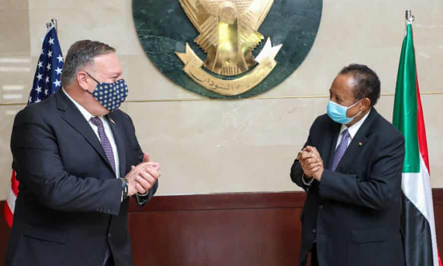The US secretary of state, Mike Pompeo (left), greets the Sudanese prime minister, Abdalla Hamdok, in Khartoum in August.