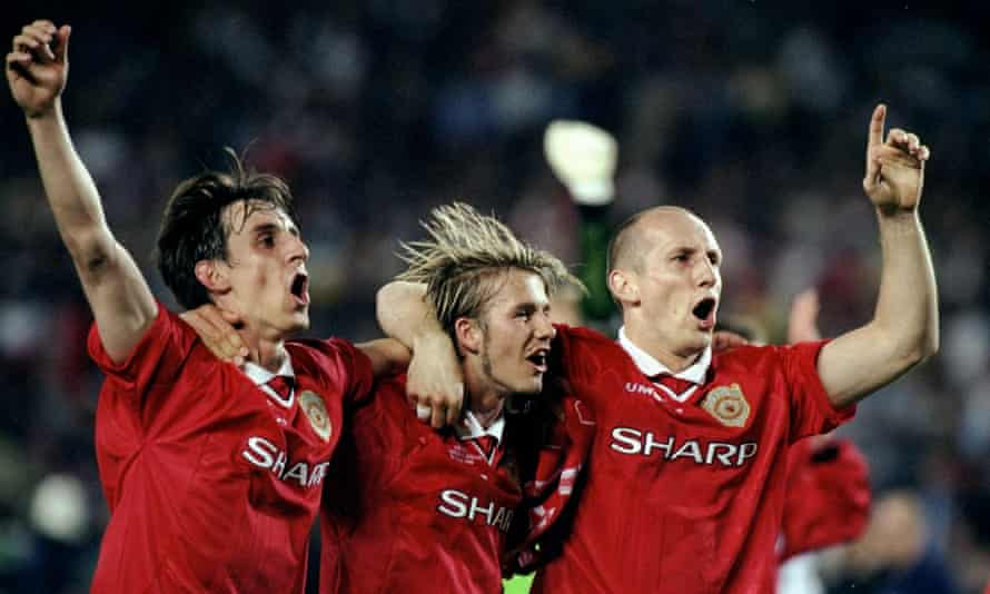 Jaap Stam celebrates Manchester United's Champions League triumph against Bayern Munich in 1999 with Gary Neville and David Beckham.