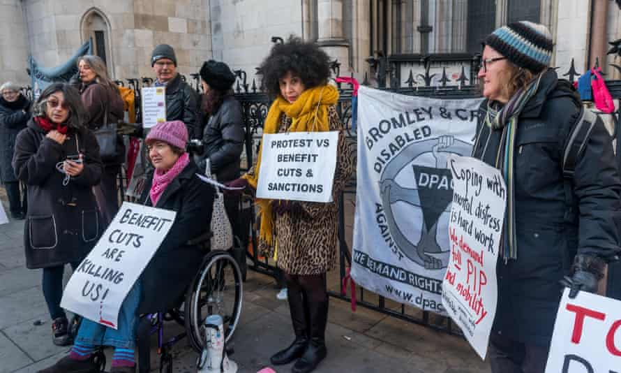 People protest against new Pip rules in London in 2017.