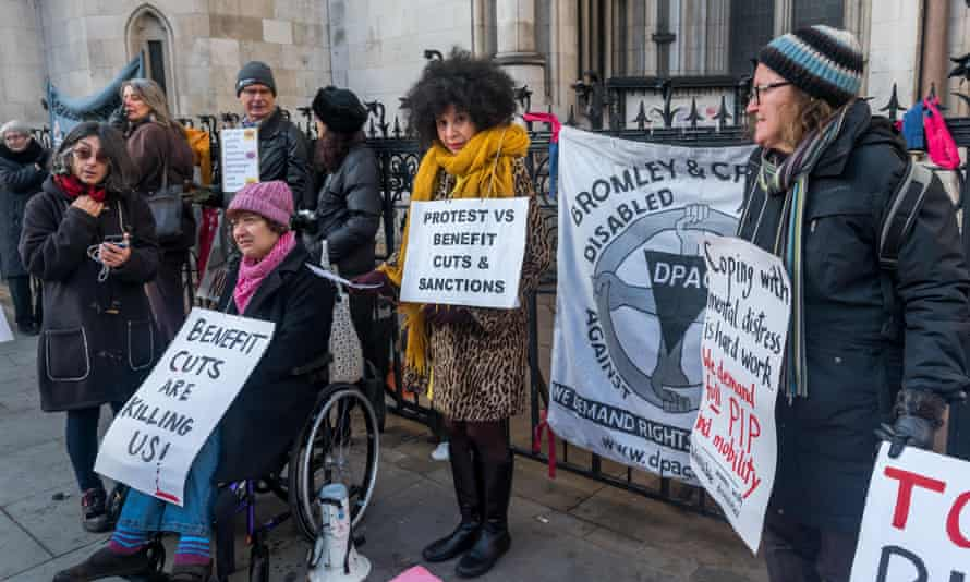 Disabled people protesting against benefit cuts