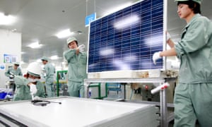 Employees assemble photovoltaic panels at Suntech Power Holdings Co.'s factory in Wuxi, Jiangsu Province, China