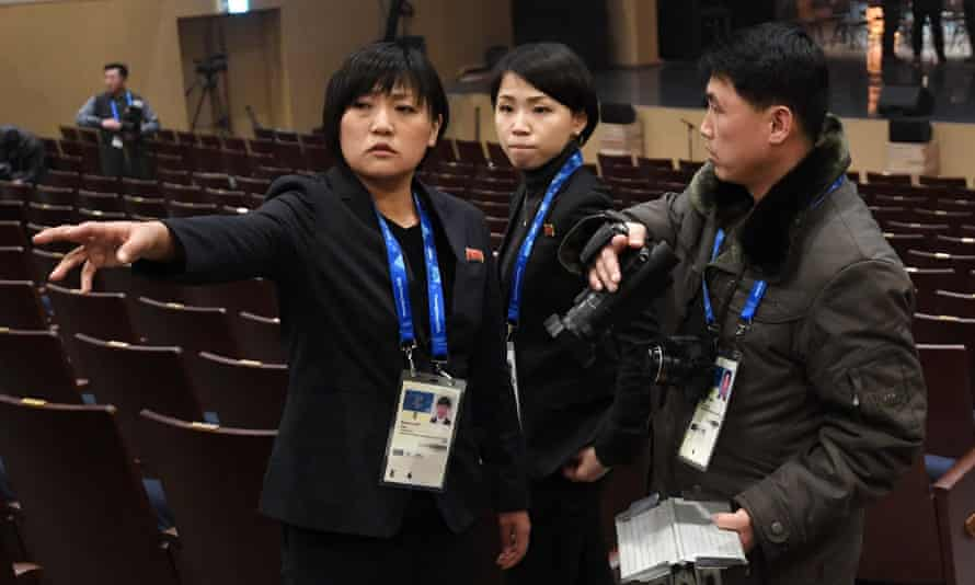 Reporters from North Korea check their equipment and the venue.