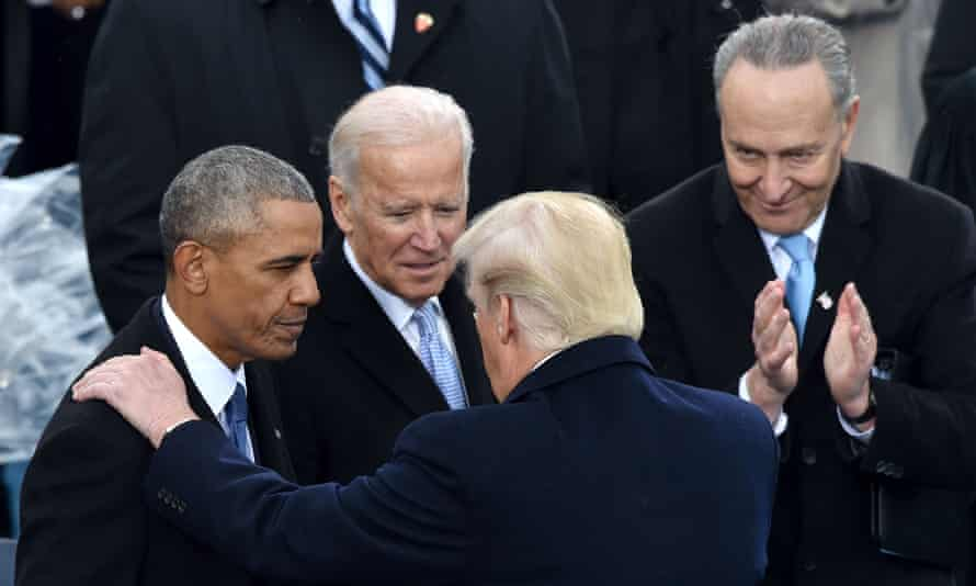 Chuck Schumer looks on as Donald Trump talks to Barack Obama and Joe Biden at the 2017 inauguration ceremony.