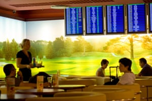 Passengers relax before departure at the cafe bar at Fryderyk Chopin Airport Warsaw.