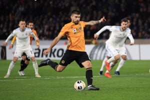 Wolves Ruben Neves misses from the spot.