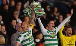 Scott Brown and Mikael Lustig lift the League Cup trophy for Celtic at Hampden Park.