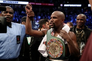 Floyd Mayweather Jr. v Conor McGregorLAS VEGAS, NV - AUGUST 26: Floyd Mayweather Jr. celebrates with the WBC Money Belt after his TKO of Conor McGregor in their super welterweight boxing match on August 26, 2017 at T-Mobile Arena in Las Vegas, Nevada. (Photo by Christian Petersen/Getty Images)
