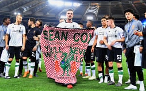 Liverpool players celebrate after the match with a banner in tribute to fan Sean Cox.