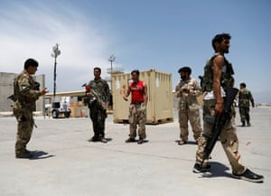 Afghan army soldiers keep watch in Bagram US air base, after American troops vacated it