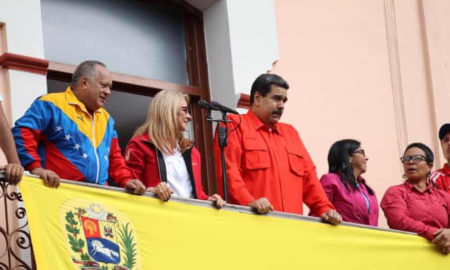 Venezuela's President Nicolás Maduro, centre, speaks to a crowd of supporters during a gathering in Caracas on Wednesday.