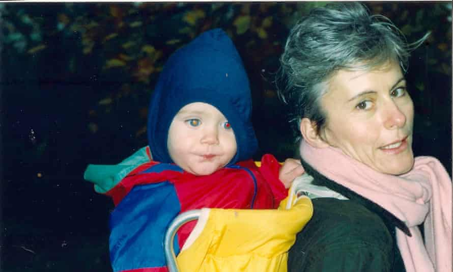 Susan Hay carrying Adam in a backpack in 1989, the year he was born.