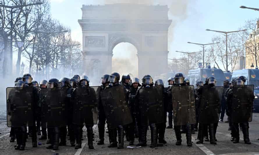 Riot police on the Champs Élysées in Paris last weekend