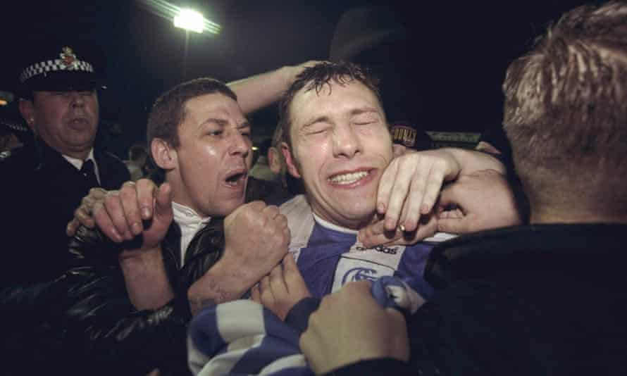 The Stockport County captain Mike Flynn with fans in 1996 after a League Cup win.
