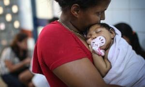 Ludmilla Hadassa Dias de Vasconcelos, who has microcephaly, is held by her grandmother