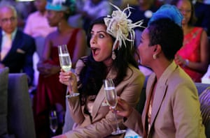 The wedding was keenly watched around the world. Pinky Ghelani and Suzzy Wokabi watch at the Windsor golf and country club in Nairobi, Kenya