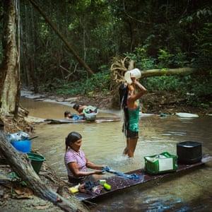 Munduruku women bathe and do laundry