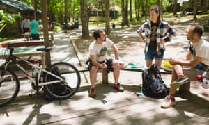 Ben Camp (right) and Jacob Winterstein (left) meet with one of Camp Bonfire's counselors. The two founders could often be seen riding bikes through the campground in order to get from one area to another.