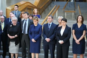 Nicola Sturgeon joins colleagues in the Garden Lobby of the Scottish parliament in Edinburgh