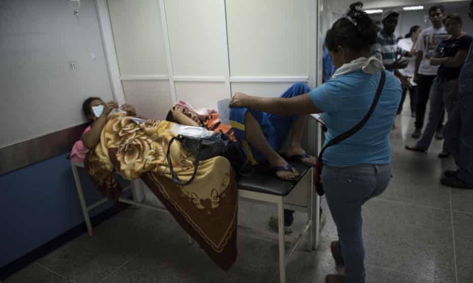 Two patients share a gurney at a hospital Barquisimeto. Healthcare provision has only deteriorated since this picture was taken in 2106.
