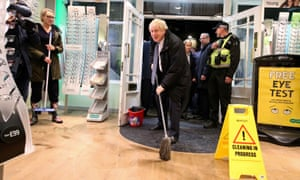 Boris Johnson mops to help clean up an optician in Matlock