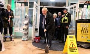 Boris Johnson using mop